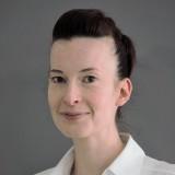 Dr.  Christine Arnold